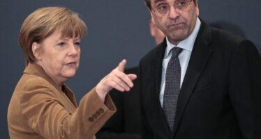 Merkel in soccorso a Samaras e in migliaia scendono in piazza